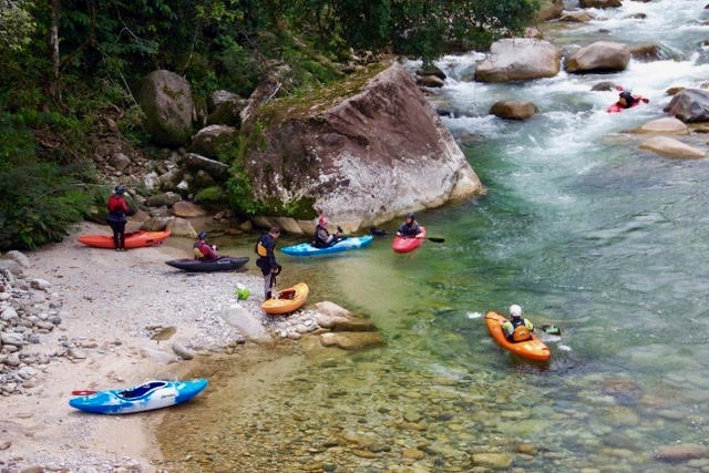 kayak ecuador, kayaking in Ecuador, ecuador kayak, kayakers kayaking in ecuador on the river Piatua