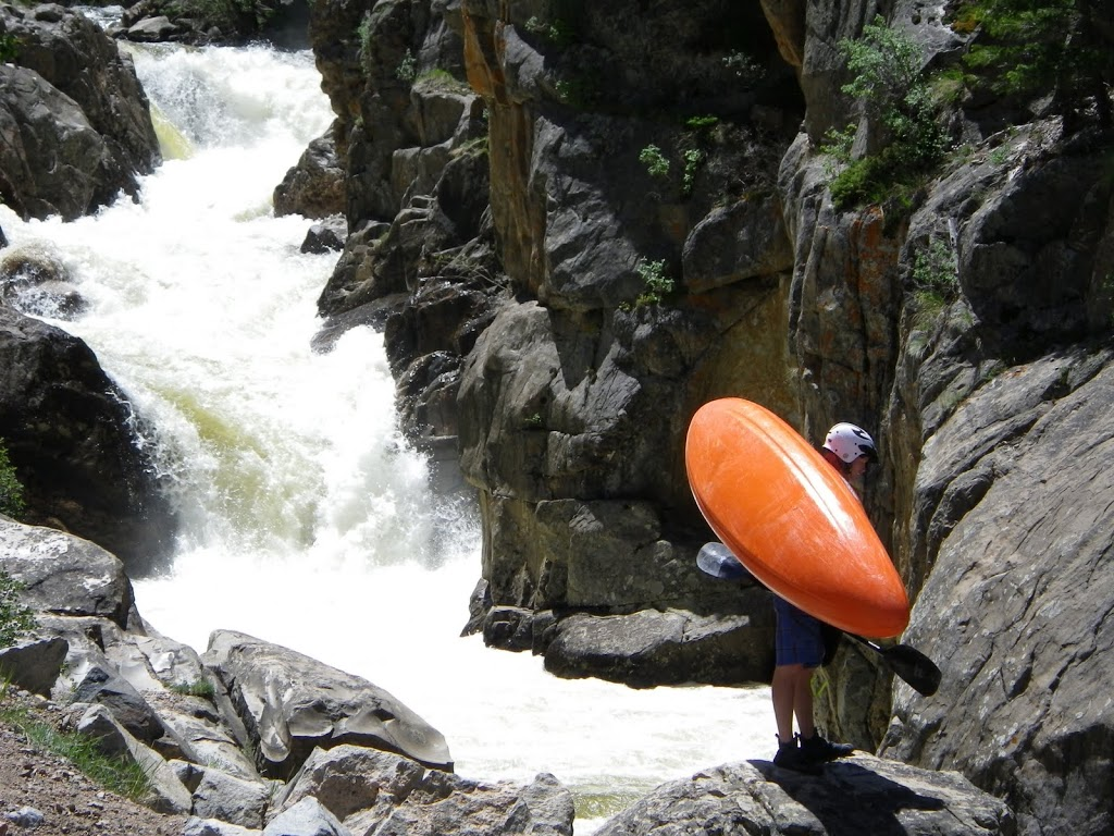 Don Scouting While Portaging Poudre Falls On The Spencer Heights Section