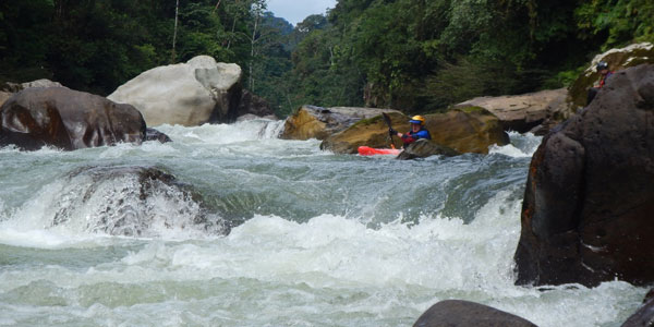 A kayaker lines up his boat to run a rapid