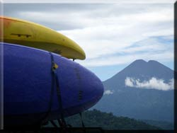 Kayaks on roof of car with view of Vulcan Sumaco in background.